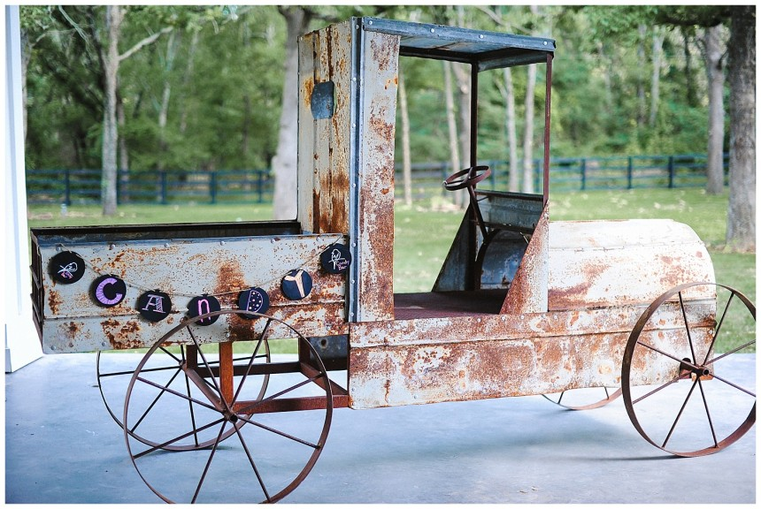 Rustic wheelbarrow at White Sparrow barn wedding venue