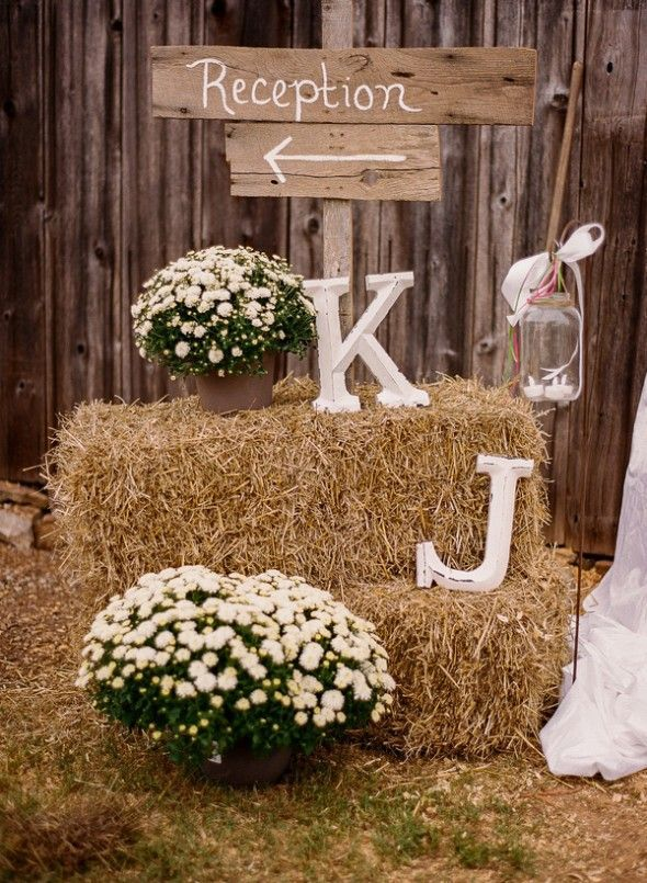 Bales of hay at rustic wedding reception