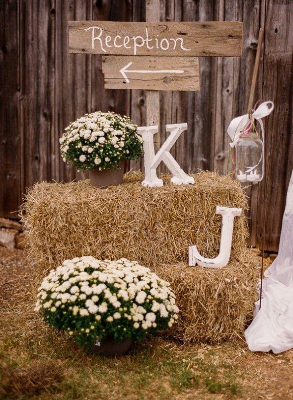 Bales of hay at rustic wedding reception